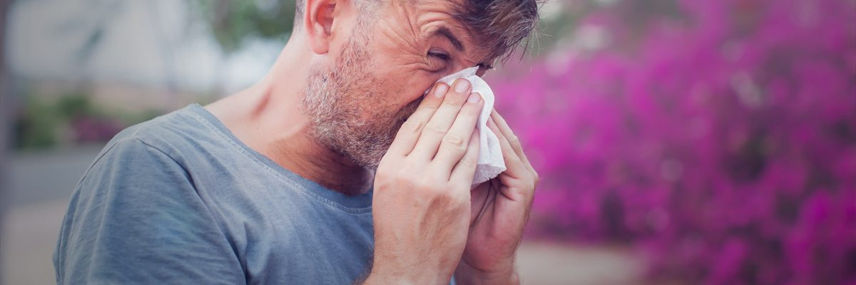 Man blowing nose / Hayfever