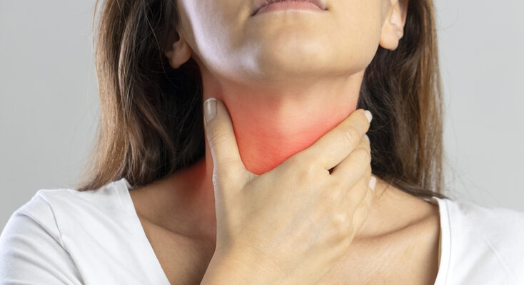Woman diagnosed with Tonsillitis exhibiting sore throat symptoms.