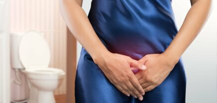 Woman holding crotch to sooth genital herpes (HSV-2) outbreak.
